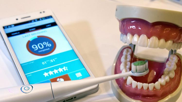 A Kolibree connected electric toothbrush is displayed during the 2014 International Consumer Electronics Show in Las Vegas