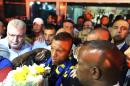 Luis Nani, centre, of Portugal, is ushered through Fenerbahce supporters that gathered to welcome him at the airport in Istanbul, late Sunday, July 5, 2015. The Portuguese international arrived to sign a contract with the Turkish club. (AP Photo)