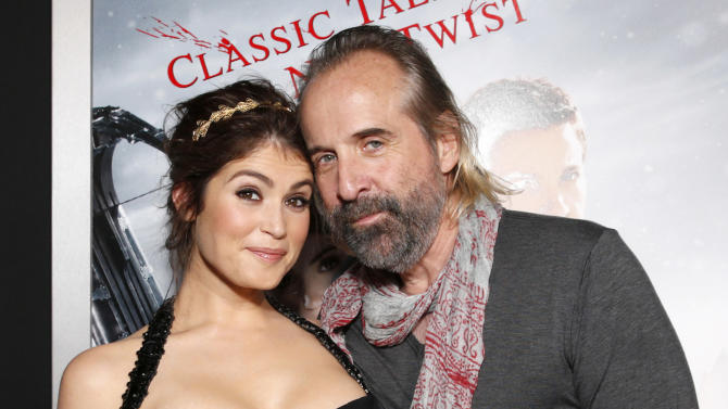 """Gemma Arterton and Peter Stormare arrive at the premiere of """"Hansel & Gretel Witch Hunters"""" on Thursday Jan. 24, 2013, in Los Angeles.  (Photo by Todd Williamson/Invision/AP)"""