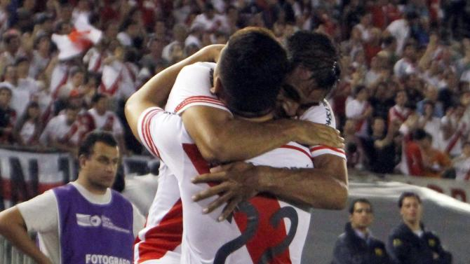 Mercado of River Plate celebrates with Driussi after scoring a goal against Libertad during their Copa Sudamericana match in Buenos Aires