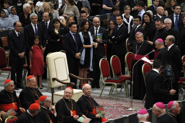 An empty papal throne is pictured as Archbishop Rino Fisichella (R) reads a message from Pope Francis before a RAI National Symphony Orchestra concert