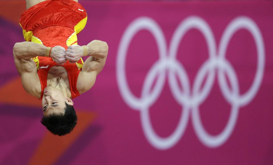 China's Feng Zhe trains on the vault during a practice session ahead of the 2012 Summer Olympics, Wednesday, July 25, 2012, in London. (AP Photo/Gregory Bull)