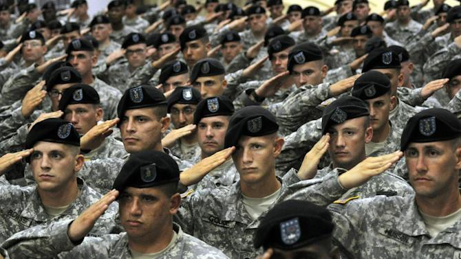 FILE - This July 28, 2010 file photo shows soldiers from the 10th Mountain Division saluting during the National Anthem during a welcome home ceremony attended by Vice President Joe Biden in Fort Drum, N.Y. In a massive restructuring, the U.S. Army is slashing the number of active duty combat brigades from 45 to 33, and shifting thousands of soldiers out of bases around the country as it moves forward with a longtime plan to cut the size of the service by 80,000. The U.S. Army plans to eliminate one of three combat brigades at northern New York's Fort Drum. (AP Photo/Heather Ainsworth, File)