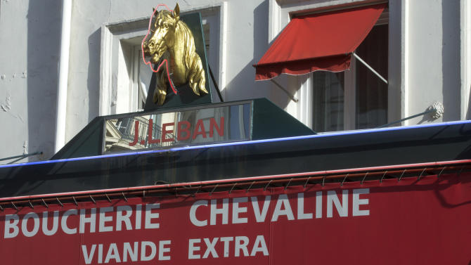 A statue of a horse's head,  above a horsemeat butcher shop  in Paris, Friday Feb 15, 2013.  Tests have found horsemeat in school meals, hospital food and restaurant dishes in Britain, officials said Friday, as the scandal over adulterated meat spread beyond frozen supermarket products. French French Consumer Affairs Minister Benoit Hamon said Thursday that it appeared fraudulent meat sales over several months reached across 13 countries and 28 companies. He identified French meat wholesaler Spanghero as a major culprit. (AP Photo/Jacques Brinon)