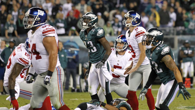 New York Giants kicker Lawrence Tynes (9) watches his 54-yard field goal attempt fall short during the second half of an NFL football game against the Philadelphia Eagles, Sunday, Sept. 30, 2012, in Philadelphia. The Eagles won 19-17. (AP Photo/Mel Evans)