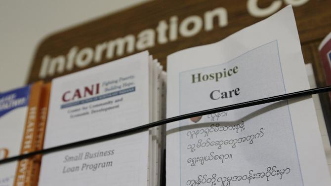In this Thursday, Sept. 20, 2012 photo, brochures are displayed in the Burmese and English language at the Burmese Advocacy Center in Fort Wayne, Ind. The center, which is funded by federal grants and private donations, helps refugees find jobs and homes and navigate issues from laws and customs to getting a driver's license. Fort Wayne, home to one of the United States' largest Burmese populations, has become an unlikely base for opposition to the country's former military regime. (AP Photo/Darron Cummings)
