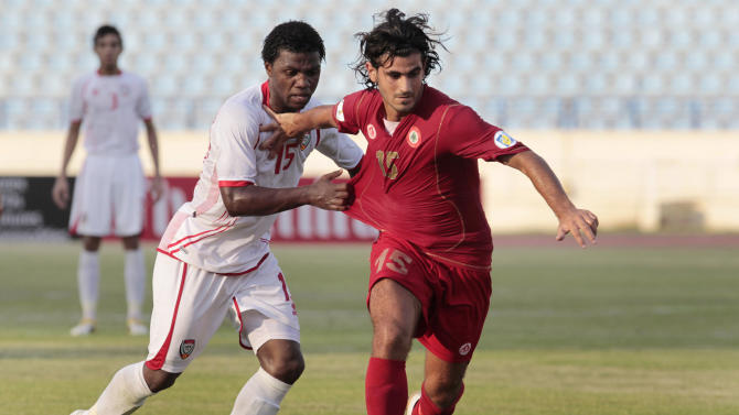 Lebanon's Haitham Faour, right, fights for the ball with United Arab Emirates' Ismail al-Hammadi, left, during their 2014 World Cup Asian Qualifiers soccer match in Beirut, Lebanon, on Tuesday Sept. 6, 2011. Lebanon won the match 3-1. (AP Photo/Hussein Malla)