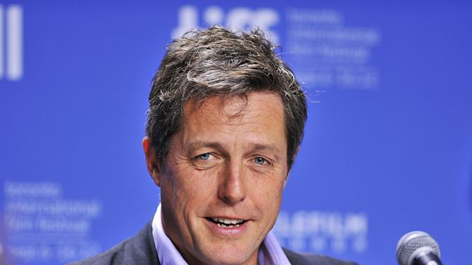 "FILE - In this Sept. 9, 2012 file photo, actor Hugh Grant speaks during the news conference for the film ""Cloud Atlas"" during the 2012 Toronto International Film Festival in Toronto. Lord Justice Brian Leveson will release his report, Thursday, Nov. 29 2012, on a year-long inquiry into the culture and practices of the British press and his recommendations for future regulation to prevent phone hacking, data theft, bribery and other abuses. (AP Photo/The Canadian Press, Aaron Vincent Elkaim, File)"