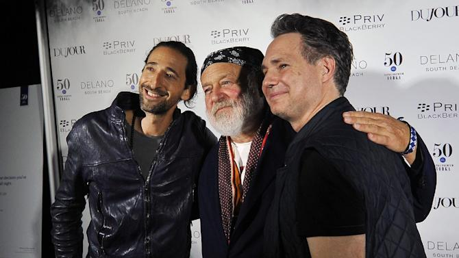 Actor Adrien Brody, from left, photographer Bruce Weber and Jason Binn pose for a photo during the annual Art Basel kick off party presented by Jason Binn publisher of DuJour Magazine at the Delano Hotel, Miami Beach on Tuesday, Dec. 1, 2015, in Miami Beach, Fla. (AP Photo/Gaston De Cardenas)FL (AP Photo/Gaston De Cardenas)