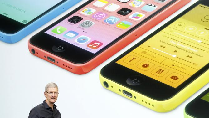 Apple Inc CEO Tim Cook talks about their new products during Apple Inc's media event in Cupertino