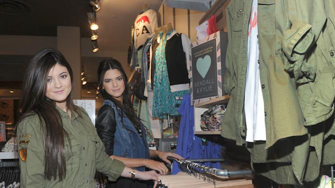 Kylie, left, and Kendall Jenner launch their exclusive Kendall & Kylie collection at PacSun, Friday, February 8, 2013, on Long Island, New York.   (Photo by Diane Bondareff/Invision for PacSun)