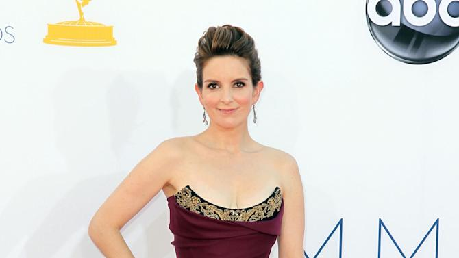 FILE - In this Sept. 23, 2012 file photo, Tina Fey arrives at the 64th Primetime Emmy Awards at the Nokia Theatre, in Los Angeles. The Hollywood Foreign Press Association, dick clark productions and NBC announced Monday, Oct. 15, 2012, that Tina Fey and Amy Poehler, have signed on to host the 70th annual ceremony after British comedian Ricky Gervais' three-year reign as the ceremony's acerbic master of ceremonies. The Golden Globes are set to air on NBC on Jan. 13, 2013. (Photo by Matt Sayles/Invision/AP, File)