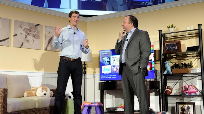 IMAGE DISTRIBUTED FOR SAMSUNG - Football quarterback Eli Manning, left, and Joe Stinziano, Executive Vice President, Samsung Electronics America, showcase the 2013 line of Smart TVs, Wednesday, March 20, 2013, in New York. Samsung's new line allows the viewer to discover more of the TV they love with a simpler, more personalized and smarter way of watching TV.  (Photo by Diane Bondareff/Invision for Samsung/AP Images)