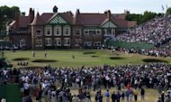 This file photo shows a general view of spectators watching British Open Golf Championship at Royal Lytham & St Annes course. More than ever the pressure will be on Englishmen Luke Donald and Lee Westwood when the tournament gets underway at the venue next Thursday. (AFP Photo/Martin Hayhow)