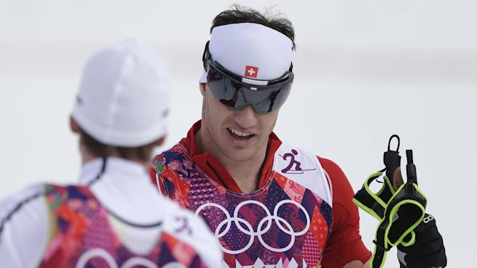 Cologna wins 15K classical race for 2nd Sochi gold