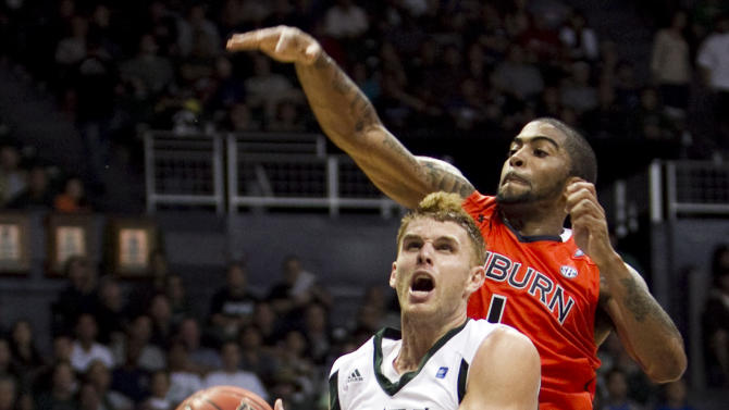 Hawaii guard Zane Johnson tries for a lay up with Auburn guard Varez Ward close behind during the second half of the NCAA college basketball game at the Stan Sheriff Center Thursday, Dec. 22, 2011 in Honolulu.  (AP Photo/Marco Garcia)