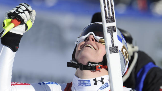 Lindsey Vonn, of the United States, celebrates at the finish area after winning an Alpine Ski World Cup women's downhill, in Cortina D'Ampezzo, Italy, Saturday, Jan.19, 2013. (AP Photo/Giovanni Auletta)