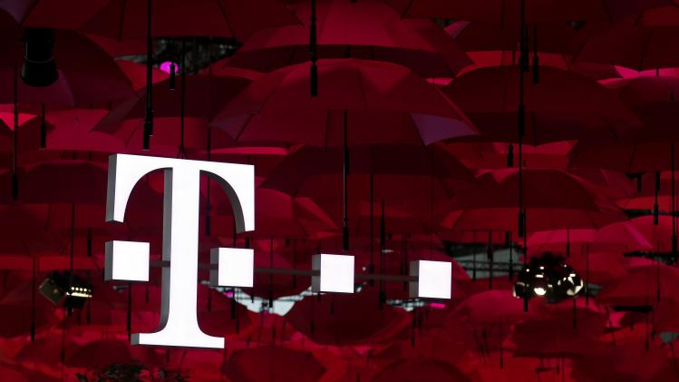 Umbrellas hang above the Telekom booth at the CeBIT trade fair in Hanover