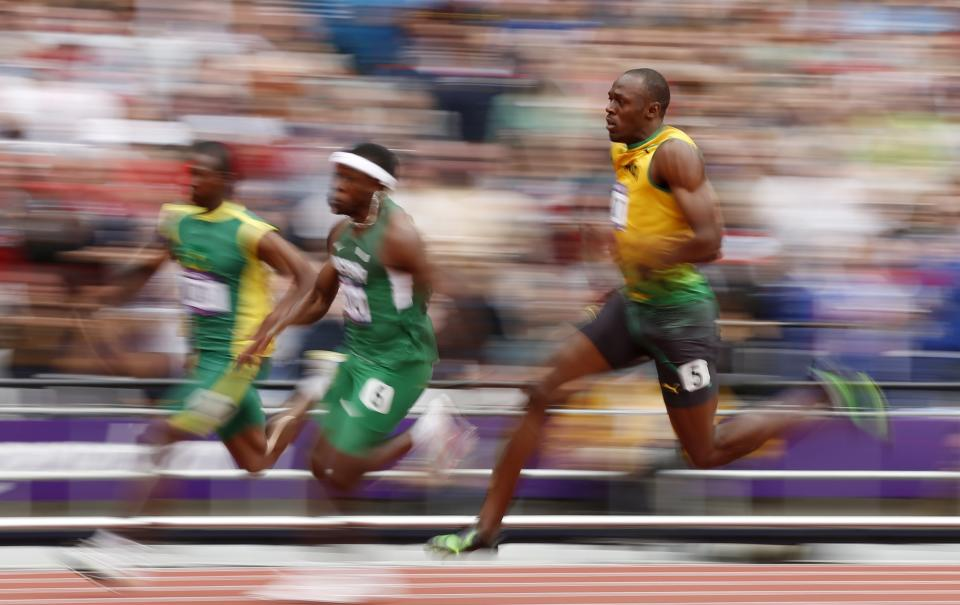 Jamaica's Usain Bolt competes in a men's 200-meter heat during the athletics in the Olympic Stadium at the 2012 Summer Olympics, London, Tuesday, Aug. 7, 2012. (AP Photo/Matt Dunham)