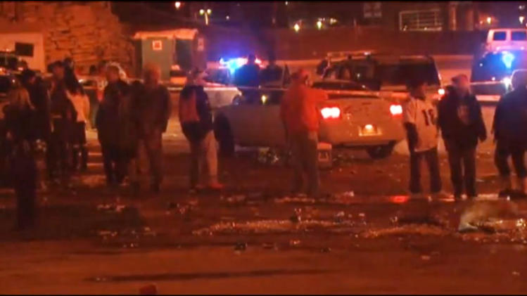 In this image from television provided courtesy of KMGH-THEDENVERCHANNEL.COM people mill around the area where at least three people were stabbed Thursday night Dec. 12, 2013 in a parking area at at Sports Authority Stadium Field at Mile High after the Denver Broncos' game. (AP Photo/KMGH-The Denverchannel.com) DENVER OUT