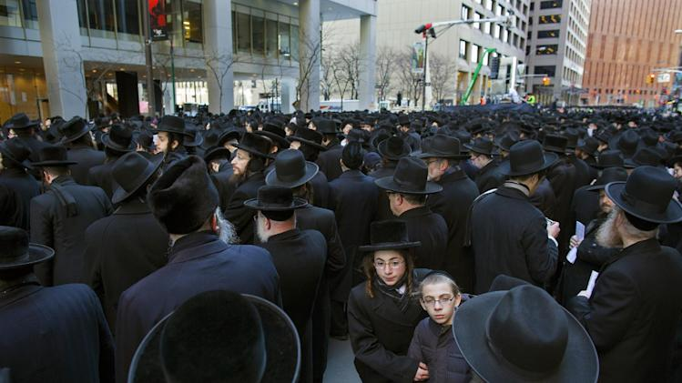 Thousands of Orthodox Jews gather in New York, Sunday, March 9, 2014, on Water Street in lower Manhattan, to pray and protest against the Israeli government's proposal to pass a law that would draft strictly religious citizens into its army. (AP Photo/Craig Ruttle)