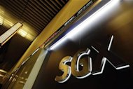The logo of the Singapore Exchange (SGX) is pictured at its office in Singapore July 25, 2012. REUTERS/Tim Chong