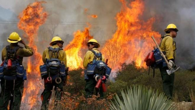 Wildfires, including this one in Glendora, Calif., burned 9.2 million acres in 2012.