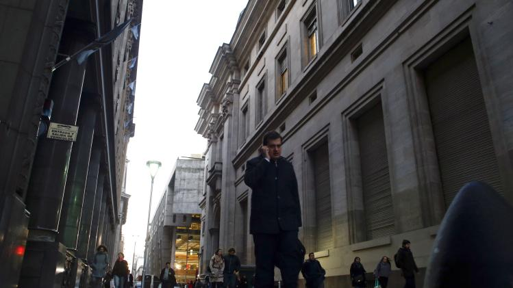 A man talks on the phone as he walks in Buenos Aires' financial district