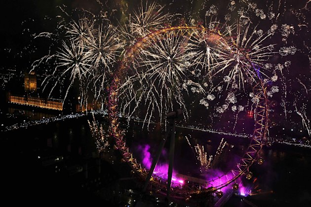 Fireworks explode from the London Eye during New Year celebrations in London