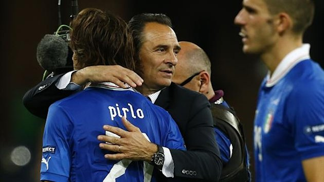 Italy's coach Cesare Prandelli (C) comforts Andrea Pirlo after losing their Euro 2012 final