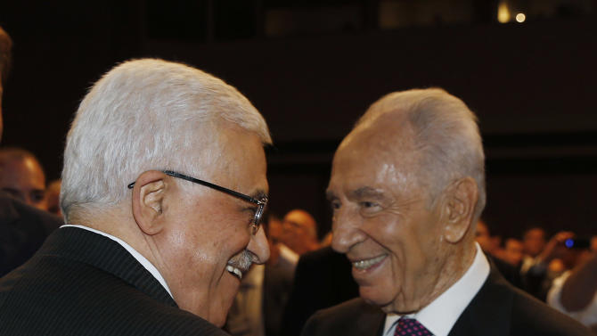 Israeli President Shimon Peres, right, and Palestinian President Mahmoud Abbas shake hands during the World Economic Forum on the Middle East and North Africa at the King Hussein Convention Centre at the Dead Sea in Jordan Sunday May 26, 2013.  (AP Photo/Pool, Jim Young)