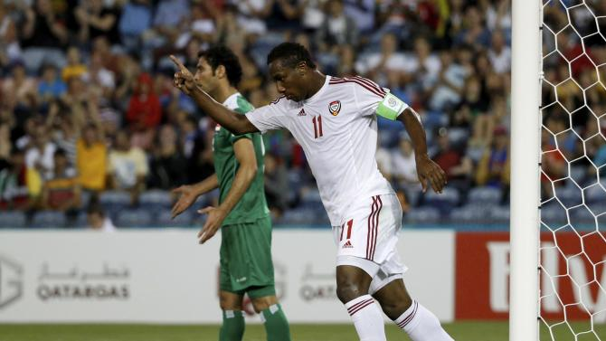 UAE's Ahmed Khalil celebrates his goal as Iraq's Saad Abdulameer Al-Dobjahawe reacts during their Asian Cup third-place playoff soccer match at the Newcastle Stadium in Newcastle