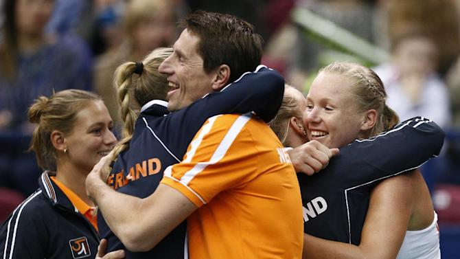 Netherlands' team players celebrate their victory over Russia's team during the Fed Cup tennis match between Russia and Netherlands in Moscow, Russia, Sunday, Feb. 7, 2016.  (AP Photo/Alexander Zemlianichenko)
