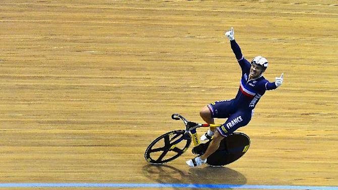 Frenchman Francois Pervis celebrates after winning a gold medal in the men's sprint final at the UCI Track Cycling World Championships at Alcides Nieto Patino velodrome, on March 2, 2014