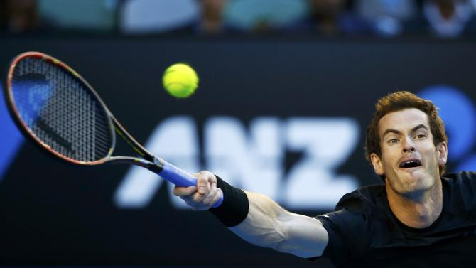 Andy Murray of Britain stretches to hit a return against Nick Kyrgios of Australia during their men's singles quarter-final match at the Australian Open 2015 tennis tournament in Melbourne