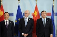 "European Commission President Jose Manuel Barroso (R) and European Union President Belgian Herman Van Rompuy (C) pose with Chinese Premier Wen Jiabao (L) during the EU-CHINA Summit in Brussels. China pledged continued assistance Thursday to help tackle the eurozone debt crisis, saying Europe was ""on the right track"" but needed to implement the measures agreed to fix its problems"