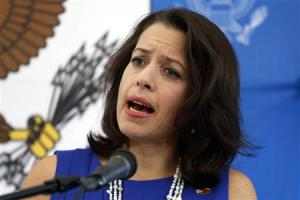 Kelly Keiderling talks to the media during a news conference at the U.S. embassy in Caracas