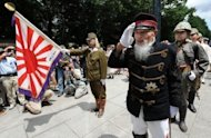 A Japanese war veteran (2nd right) visits the Yasukuni Shrine to pray for war victims in Tokyo. Nearly seven decades after Japan surrendered, leadership changes in Northeast Asia are fuelling territorial disputes that are themselves the legacy of a war the region never really settled, analysts say