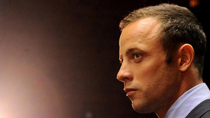 FILE - In this Friday, Feb. 22, 2013 file photo Olympic athlete Oscar Pistorius stands in the dock during his bail hearing at the magistrates court in Pretoria, South Africa. South Africa's police commissioner office said Tuesday Aug. 13, 2013 that Oscar Pistorius will be served with an indictment next week after police completed an investigation into the shooting death of his girlfriend. On Monday August 19, the accused,Oscar Pistorius, will appear on court in Pretroia. It is expected that he will be served with an indictment and that the matter will be postponed. The prosecution, in collaboration with the defence team, will agree on a trial date. (AP Photo/Themba Hadebe-file)