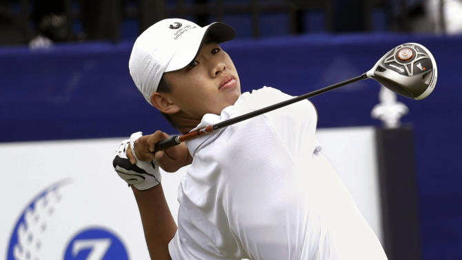 Guan Tianlang, 14, from China,  tees off on the first hole of the first round of the PGA Tour Zurich Classic golf tournament at TPC Louisiana in Avondale, La., Thursday, April 25, 2013. (AP Photo/Gerald Herbert)