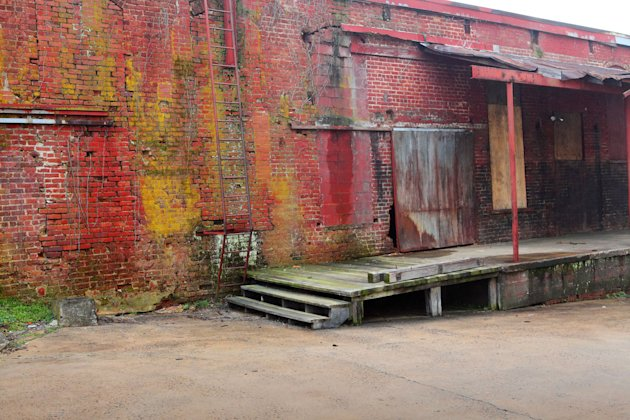 "This undated image provided by VisitNC.com shows the warehouse space in Shelby, N.C., which was used for reaping scenes in ""The Hunger Games"" movie. The movie was filmed entirely in North Carolina, wh"