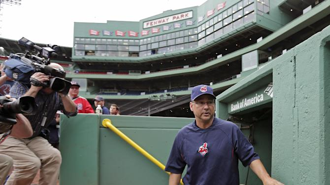 Cleveland Indians manager Terry Francona walks past photographers as he heads to the bench of the visitor's dugout before a baseball game against the Boston Red Sox at Fenway Park in Boston, Thursday, May 23, 2013. Francona was Red Sox manager for the 2004 and 2007 World Series Championship seasons. (AP Photo/Charles Krupa)