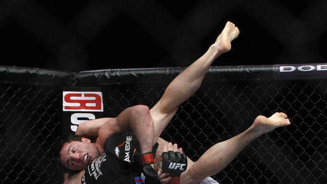 """Chael Sonnen throws down Brian Stann in a middleweight bout where Sonnen won in two rounds before the UFC 136 lightweight title bout with Gray """"The Bully"""" Maynard and Frankie """"The Answer""""  Edgar at Toyota Center Saturday, Oct. 8, 2011, in Houston.   (AP Photo/ Houston Chronicle,Johnny Hanson)"""