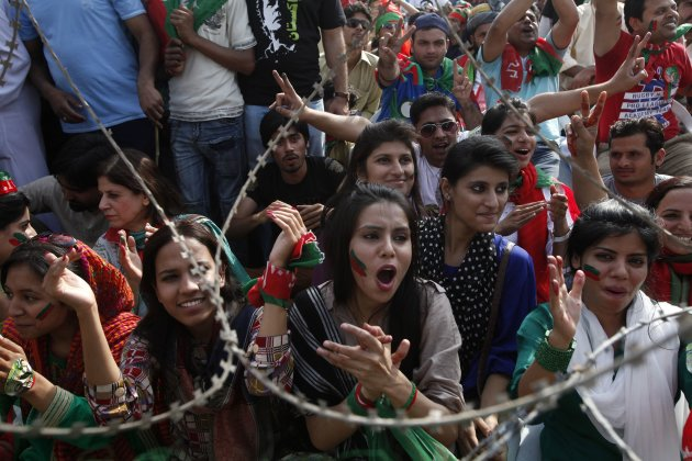 Supporters of the political party Pakistan Tehreek-e- Insaf (PTI) shout slogans during a rally in Lahore