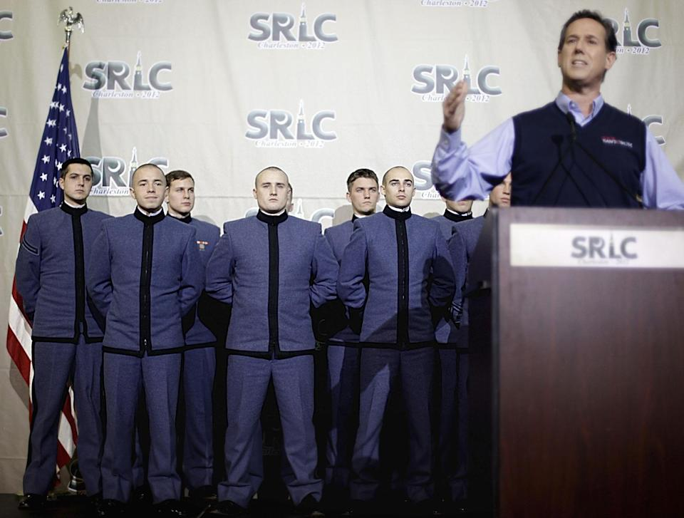 Students from Citadel Military College of South Carolina watch as Republican presidential candidate former Pennsylvania Sen. Rick Santorum speaks to the Southern Republican Leadership Conference Thursday, Jan. 19, 2012, in Charleston, S.C. (AP Photo/David Goldman)