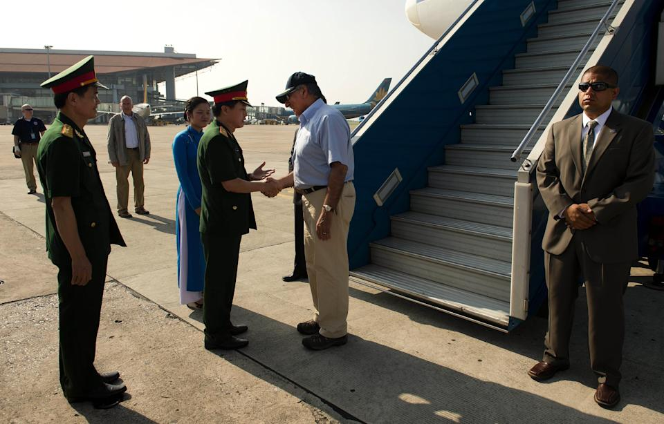 U.S. Secretary of Defense Leon Panetta, center, is greeted by Vietnamese officials upon his arrival at Noi Bai International Airport in Hanoi, Vietman, Sunday, June 3, 2012. (AP Photo/Jim Watson, Pool)