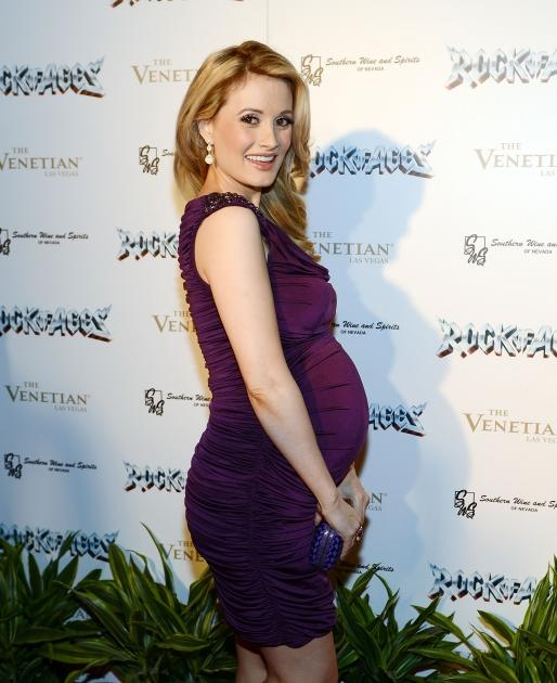 Baby bumpin'! Holly Madison flashes a smile at the Rock Of Ages opening after party at The Venetian in Las Vegas on January 5, 2013  -- Getty Premium