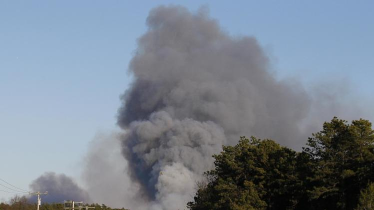 Smoke billows from a fire into the sky over Berkeley Township