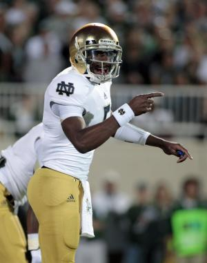 Notre Dame quarterback Everett Golson signals during the first quarter of an NCAA college football game against Michigan State, Saturday, Sept. 15, 2012, in East Lansing, Mich. (AP Photo/Al Goldis)