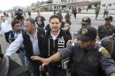 Former Guatemalan president Portillo is escorted before boarding plane for his extradition to United States for money laundering, in Guatemala City